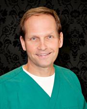 Dr-Jay-Balasz-Charlevoix-Dentist---Portrait-in-Surgical-ScrubsV2Dr-Jay-Balasz-Charlevoix-Dentist---Portrait-in-Surgical-ScrubsV2